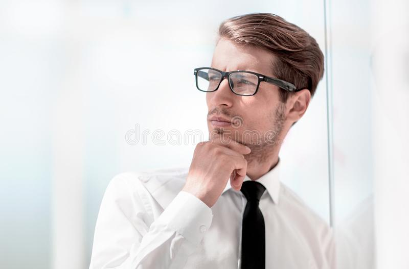 Close up.pensive businessman standing in office. royalty free stock photos