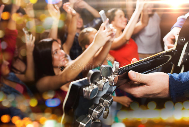 Close up of people at music concert in night club royalty free stock photography