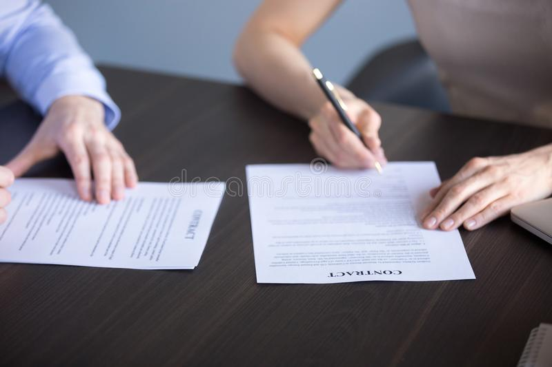 Close up of people sign documents during business meeting stock photography