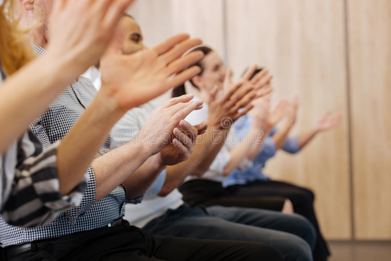 Close up of peoples hands applauding stock image