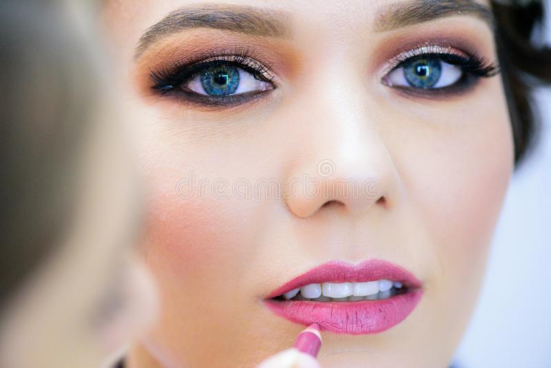 Closeup perfect natural lip makeup.Clean skin, fresh make-up. Spa tender lips. Augmentation, glamour. royalty free stock images