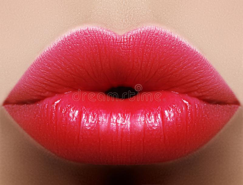 Closeup kiss red lip makeup. Beautiful plump full lips on female face. Clean skin, fresh make-up. Bright lips. Close-up perfect red lip makeup beautiful female royalty free stock images