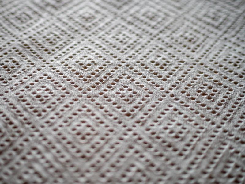 Close up of perforated kitchen paper with diamond pattern stock image
