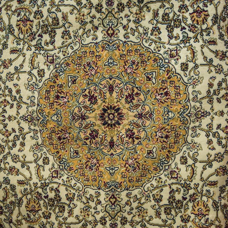 Close up of Persian carpet. An extrem close up of intricately woven Middle eastern carpet design royalty free stock photography