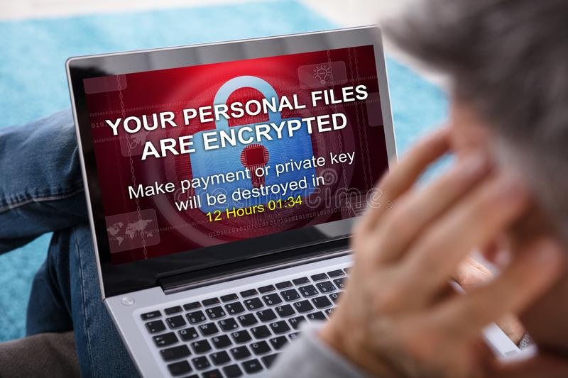 Person Looking At Laptop Screen. Close-up Of A Person Looking At Laptop Screen Showing Personal Files Encrypted Text stock photos