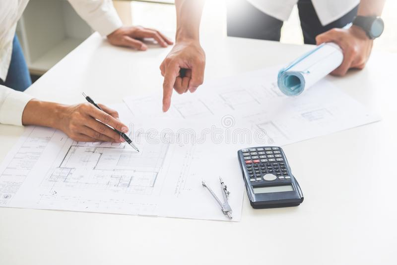 Close-up Of Person`s engineer Hand Drawing Plan On Blue Print wi. Th architect equipment, Architects discussing at the table, team work and work flow stock image