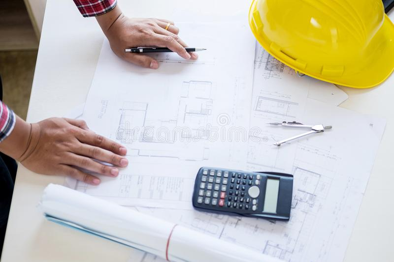 Close-up Of Person`s engineer Hand Drawing Plan On Blue Print wi. Th architect equipment, Architects discussing at the table, team work and work flow royalty free stock images
