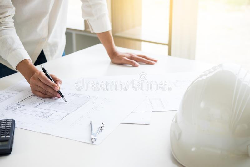 Close-up Of Person`s engineer Hand Drawing Plan On Blue Print wi. Th architect equipment, Architects discussing at the table, team work and work flow stock photography