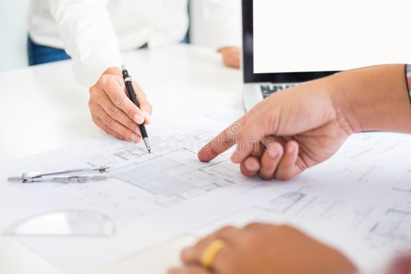 Close-up Of Person`s engineer Hand Drawing Plan On Blue Print wi. Th architect equipment, Architects discussing at the table, team work and work flow stock images
