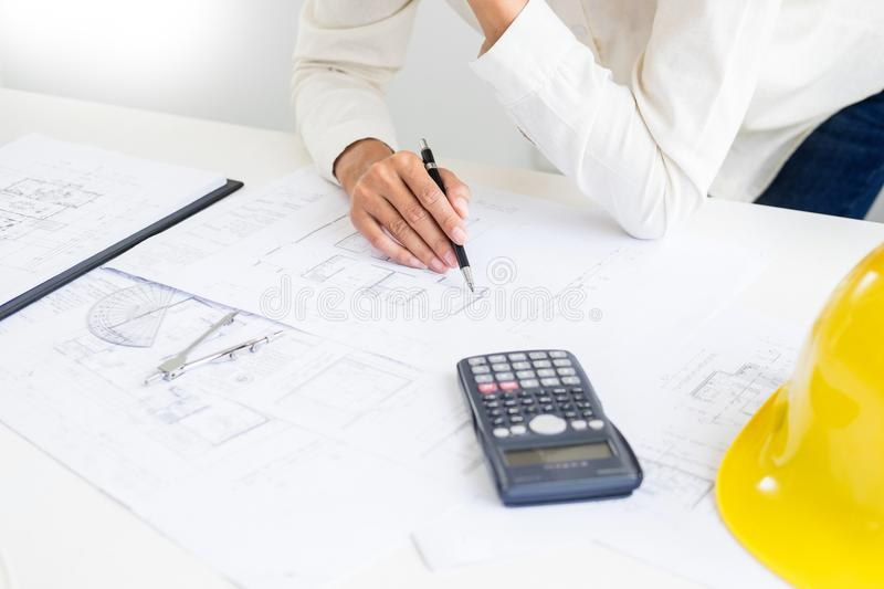 Close-up Of Person`s engineer Hand Drawing Plan On Blue Print wi. Th architect equipment, Architects discussing at the table, team work and work flow royalty free stock photos