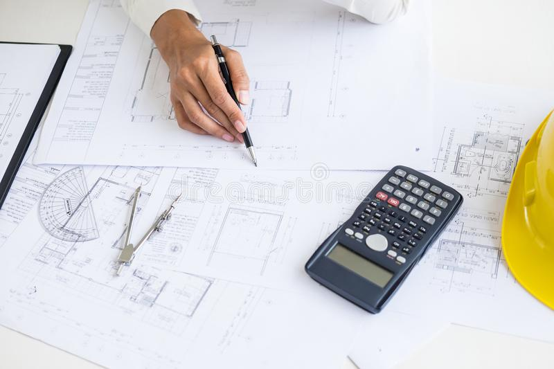 Close-up Of Person`s engineer Hand Drawing Plan On Blue Print wi. Th architect equipment, Architects discussing at the table, team work and work flow royalty free stock photo