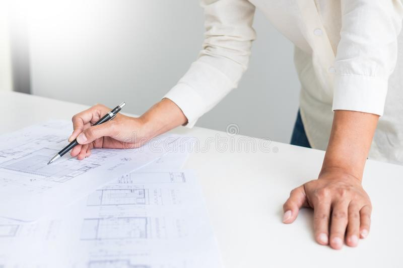 Close-up Of Person`s engineer Hand Drawing Plan On Blue Print wi. Th architect equipment, Architects discussing at the table, team work and work flow stock photos