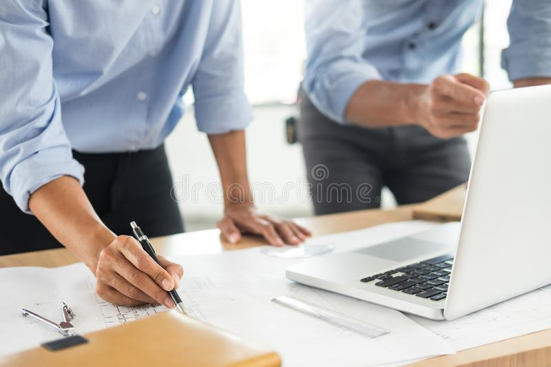 Close-up Of Person`s engineer Hand Drawing Plan On Blue Print wi. Th architect equipment, Architects discussing at the table, team work and work flow royalty free stock photography