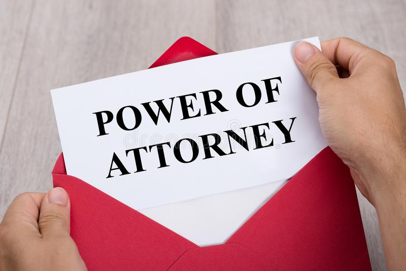 Person Holding Power Of Attorney Document In Envelope royalty free stock photos