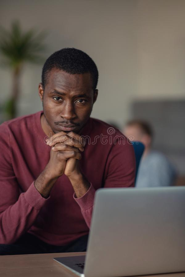 Close-up Of Person Typing On Laptop At startup office. stock image
