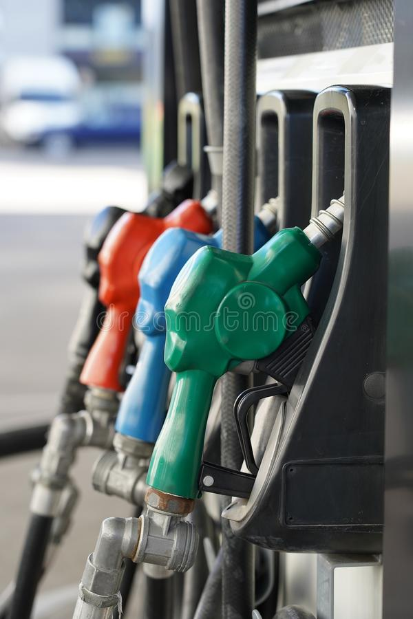 Petrol pump filling nozzles. Fuel at gas station close up royalty free stock photos