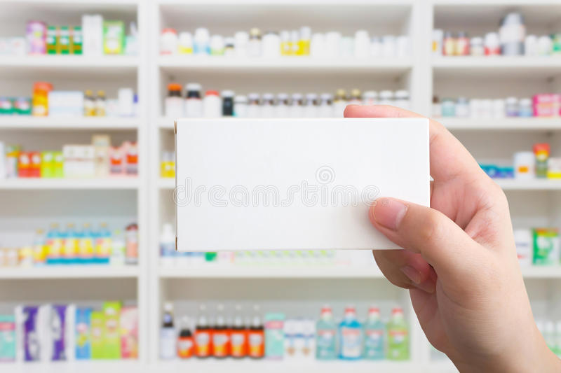 Close up pharmacist hand hold medicine box package stock photos
