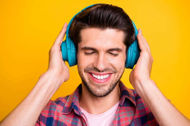 Close up photo of admiring man who cannot stop listening to his favorite musician while isolated with vivid background stock photos