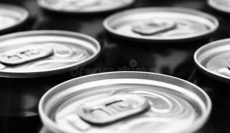 Close up photo of aluminium cans in a raw. Aluminium can background. Can Pattern. Aluminium beverage cans. Drink can. Metal contai. Ners for packaging drinks royalty free stock photos