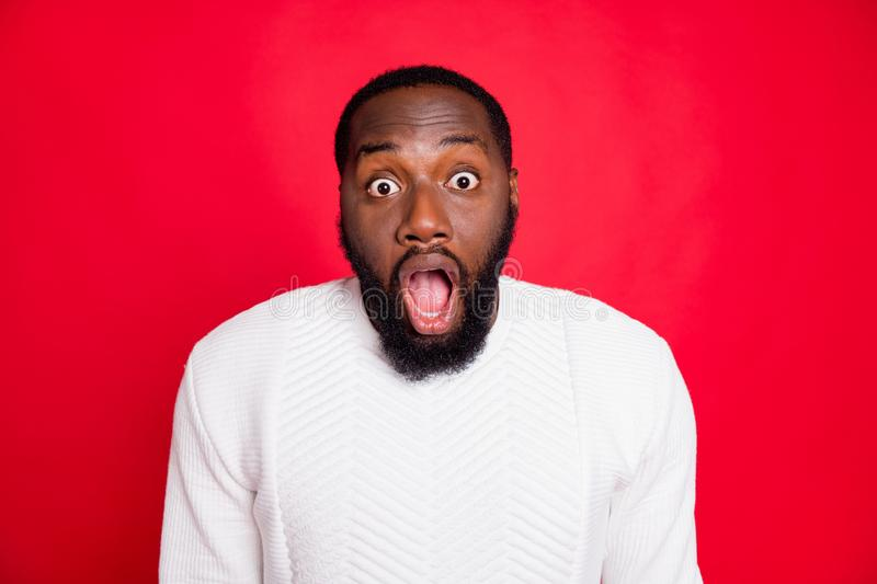 Close up photo of amazed impressed african man hear listen incredible news scream wow omg wear white jumper clothes. Close up photo of amazed impressed african stock photos