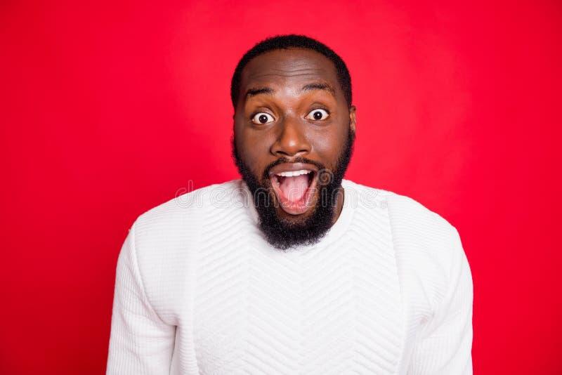 Close up photo of amazed surprised dark skin man hear wonderful incredible news about xmas discounts scream wow omg wear. Close up photo of amazed surprised dark royalty free stock photos