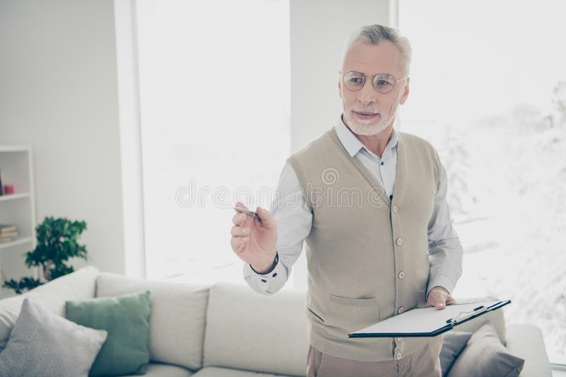 Close up photo amazing he him his aged man arm hand show hospitality skilled specialist hold pen noticing contract. Close up photo amazing he him his aged man royalty free stock photos