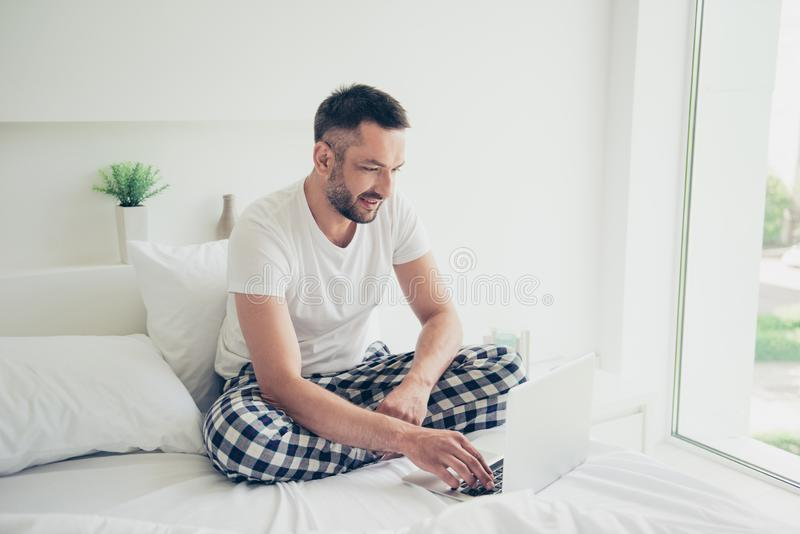 Close up photo amazing he him his guy good morning weekend workaholic notebook writing check currency white nightwear royalty free stock image