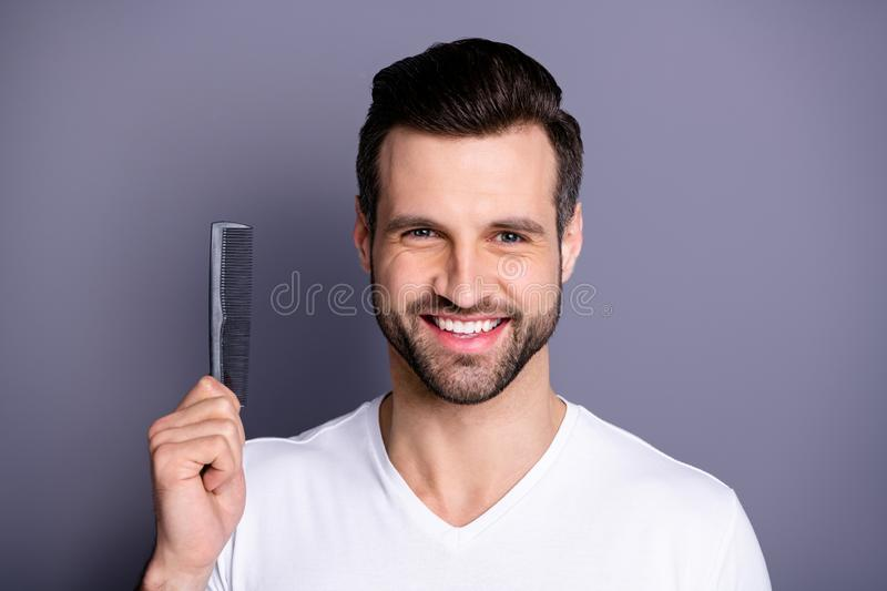 Close up photo amazing he him his macho advising buy buyer new hand arm plastic hair styling brush take care hairdo. Close up photo amazing he him his macho royalty free stock photos