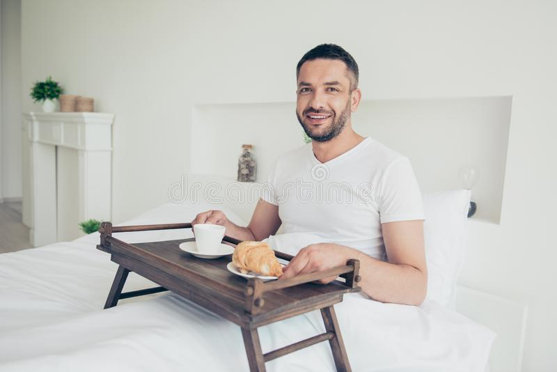 Close up photo amazing he him his macho attractive guy glad early morning sweet bakery breakfast coffee beverage little royalty free stock image