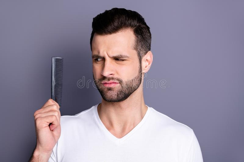 Close up photo amazing he him his macho deny not sure action new hand arm plastic hair styling brush take care hairdo. After barber shop stylist visit wear stock photo