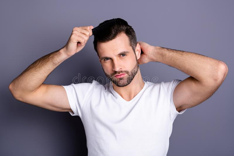 Close up photo amazing he him his macho perfect appearance hands arms plastic hair styling brush take care hairdo after. Close up photo amazing he him his macho royalty free stock image
