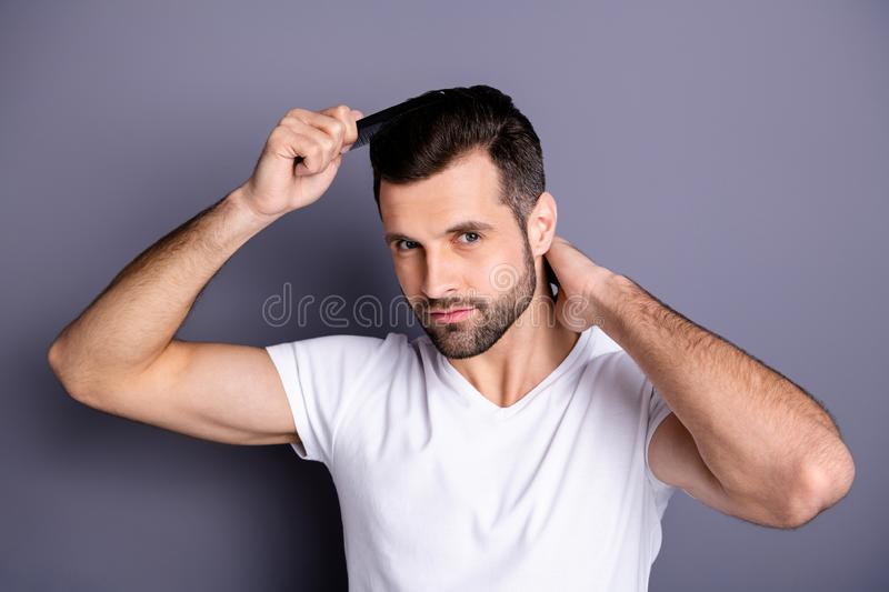Close up photo amazing he him his macho perfect appearance hands arms plastic hair styling brush take care hairdo after. Barber shop, stylist visit wear casual royalty free stock photo