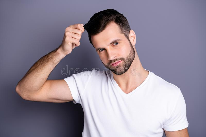 Close up photo amazing he him his macho perfect appearance hands arms plastic hair styling brush take care hairdo after. Close up photo amazing he him his macho stock photos