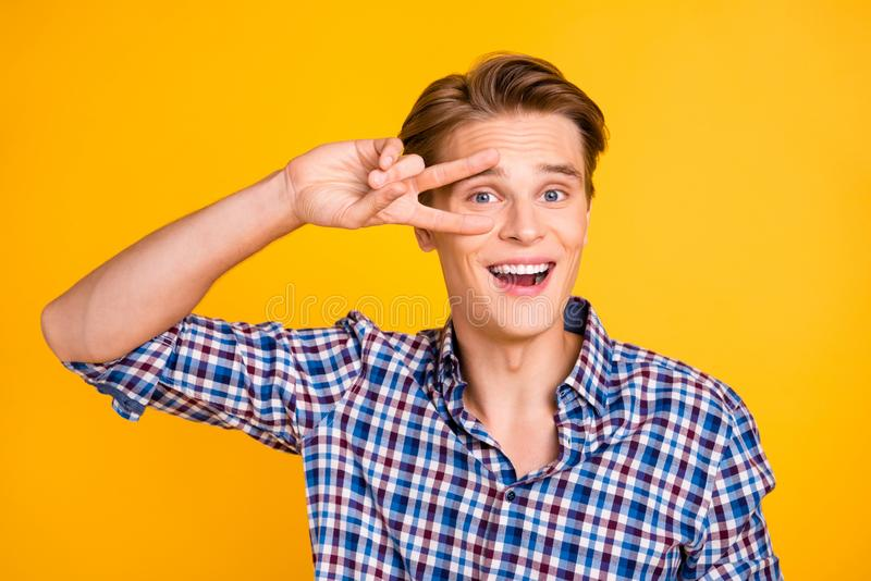 Close up photo amazing he him his man arms hands show v-sign near eye say hi amazed excited mood perfect hairdo styling. Wearing casual plaid checkered shirt royalty free stock images