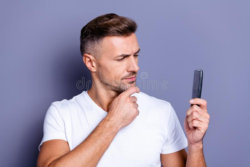 Close up photo amazing he him his middle age macho perfect appearance hands arms chin look plastic hair styling brush. Close up photo amazing he him his middle stock image