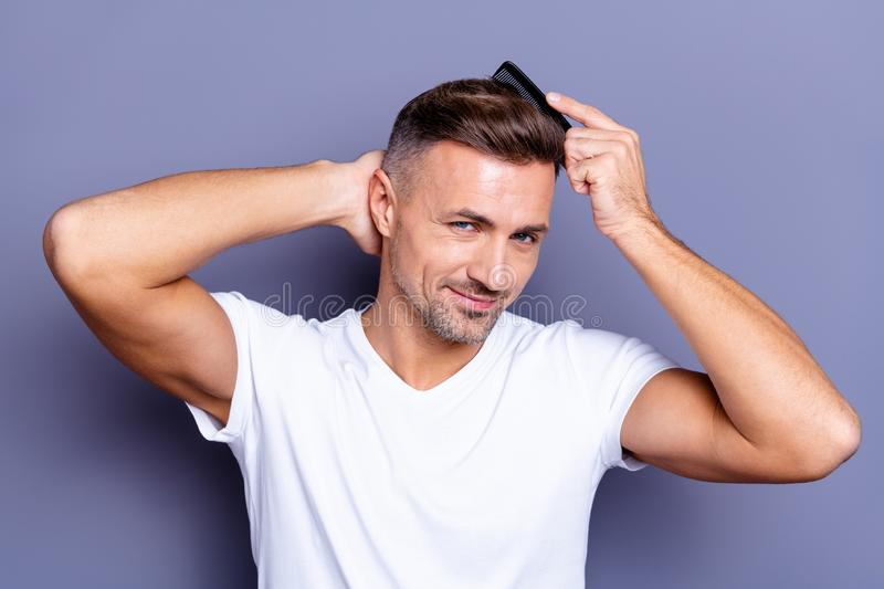 Close up photo amazing he him his middle age macho perfect appearance hands arms plastic hair styling brush take care. Close up photo amazing he him his middle stock photography