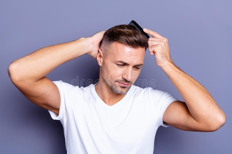 Close up photo amazing he him his middle age thought thoughtful macho hands arms plastic hair styling brush take care. Hairdo after, barber shop visit wear royalty free stock photography