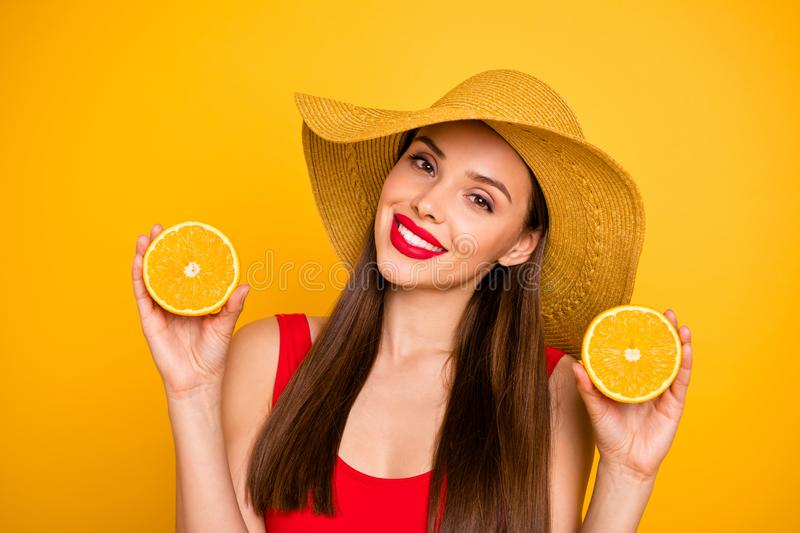 Close up photo of amazing lady bright lips nice colorful look orange slices hands trip fresh cocktail wear sun hat red royalty free stock photo