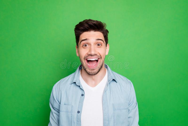 Close up photo of amazing macho guy revealing perfect white teeth looking on unbelievable low prices wear casual denim stock photography