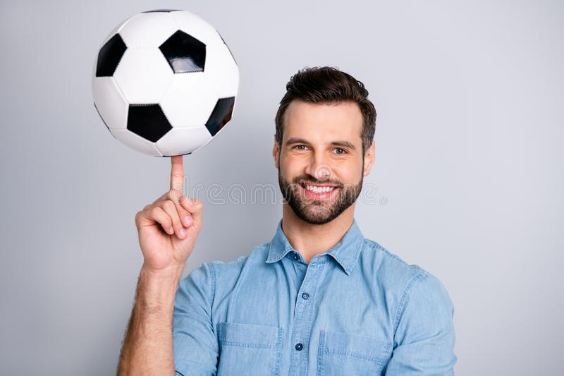 Close up photo amazing macho he him his guy show hand arm finger hold football leather ball round moves show cool tricks. Wear casual jeans denim shirts outfit royalty free stock photos