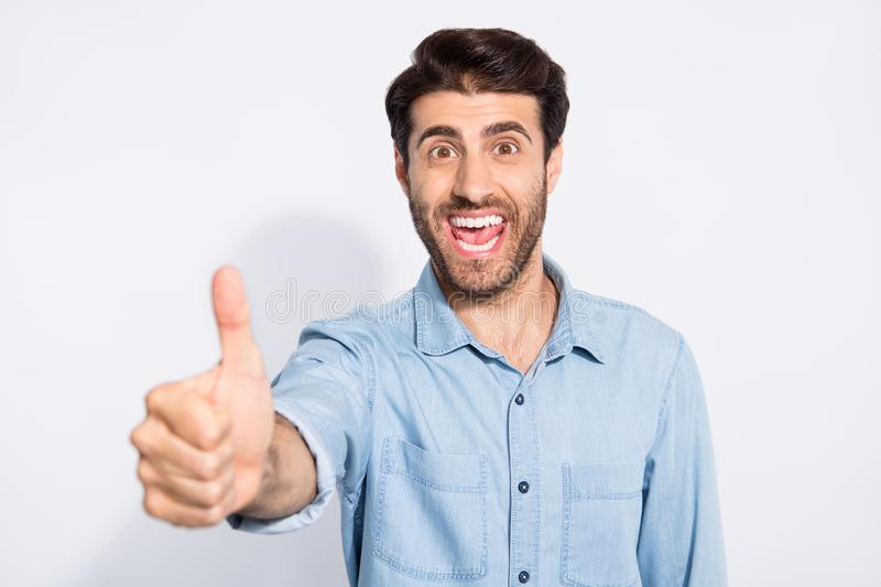 Close up photo of amazing mixed race multiethnic macho guy raising thumb up express positive attitude wear casual denim stock photos