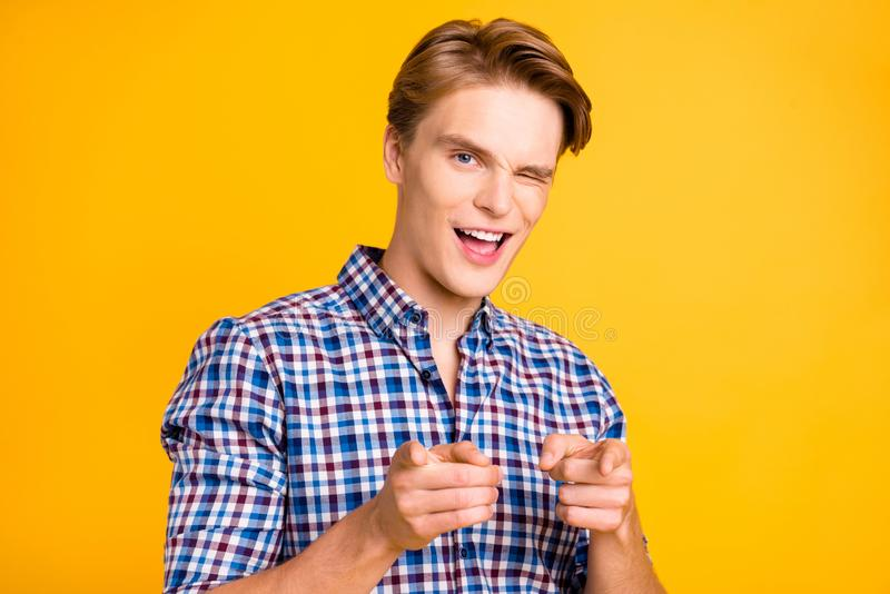 Close up photo amazing youngster he him his man arms hands fingers air blink one eye indicating I pick only you wearing. Casual plaid checkered shirt outfit royalty free stock images