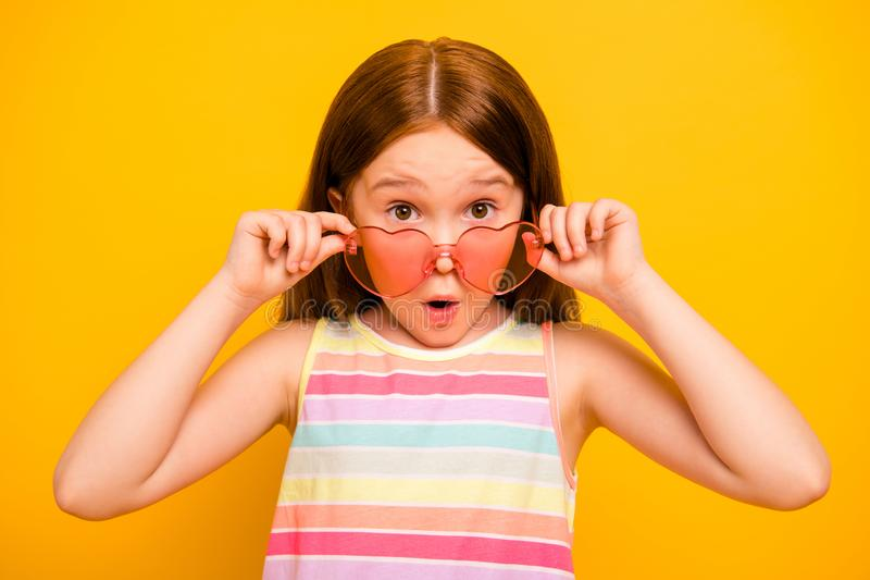 Close up photo of astonished girl touching her specs wearing singlet isolated over yellow background. Close up photo of astonished, girl touching her specs royalty free stock image