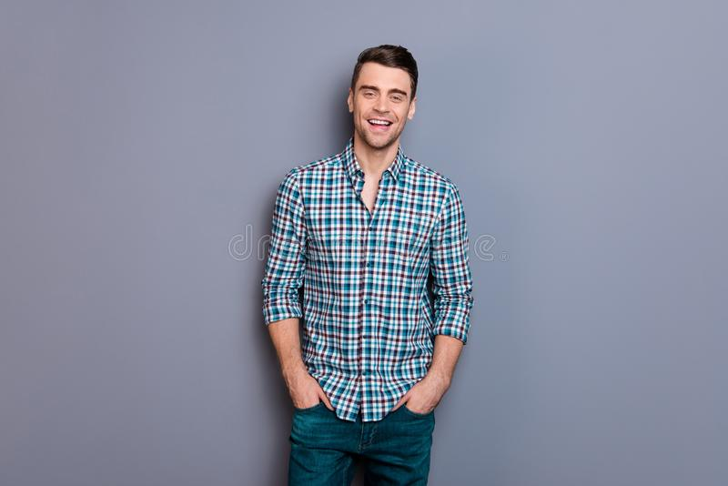 Close up photo attractive amazing he him his man arms hands in pockets ideal perfect hairdo styling easy-going wearing. Casual plaid checkered shirt jeans denim stock images