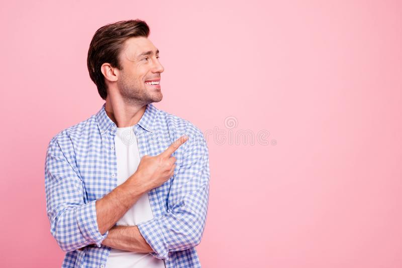 Close up photo of attractive smiling glad he him his man arm finger showing to empty space you need to see watch it royalty free stock photos