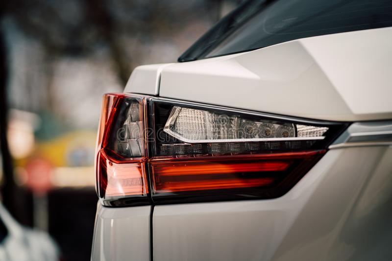 Close up photo of back view luxury car with futuristic tail lights stock photo