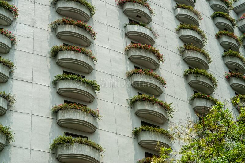 Close-up photo of balconies covered with flowers. Abstract on the subject of modern architecture,landscaping buildings. Close-up photo of balconies covered with royalty free stock images