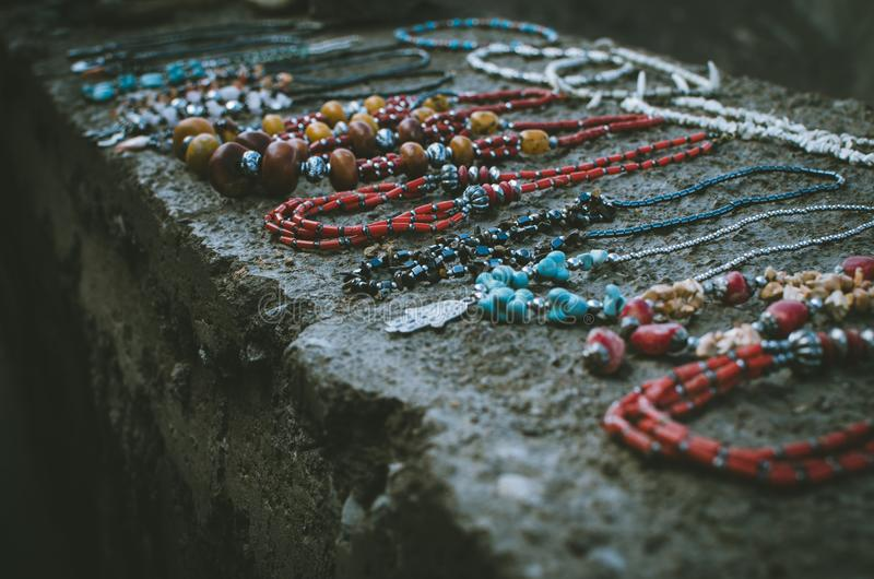 Close Up Photo of Beaded Accessories on Gray Surface stock images