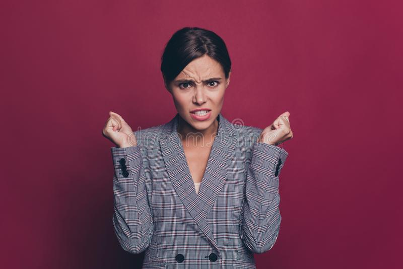 Close up photo beautiful amazing business she her lady arm hand fingers fists in air evil displeased violence facial. Expression wearing specs formal-wear  dark stock photography
