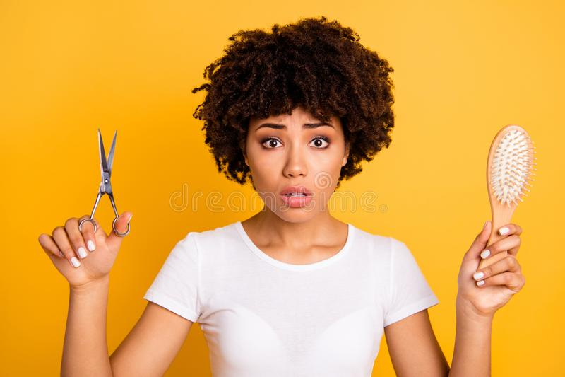 Close up photo beautiful amazing she her dark skin lady hold hair brush scissors hands pros cons minus plus of changing royalty free stock photography